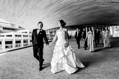 Bride and Groom Walking near Calgary Central Library