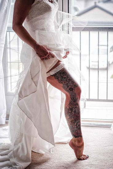 Bride With a Tattooed Leg Getting Ready