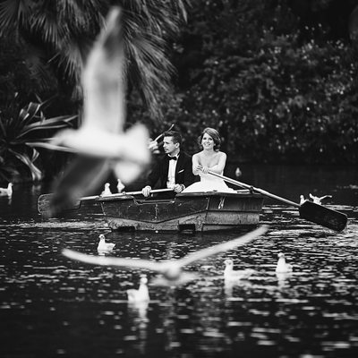 Barcelona Bride and Groom rowing midst of seagulls