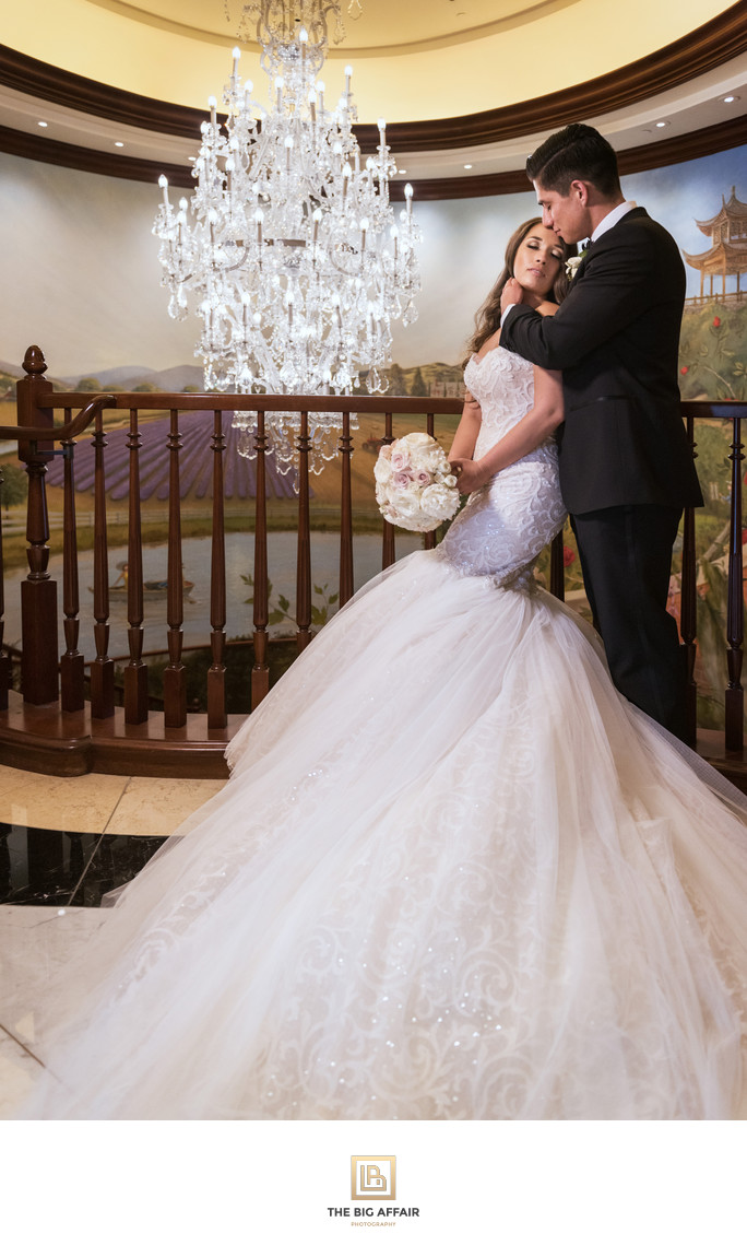 Ashley and George romantic portrait by chandelier at Four Seasons Westlake Village