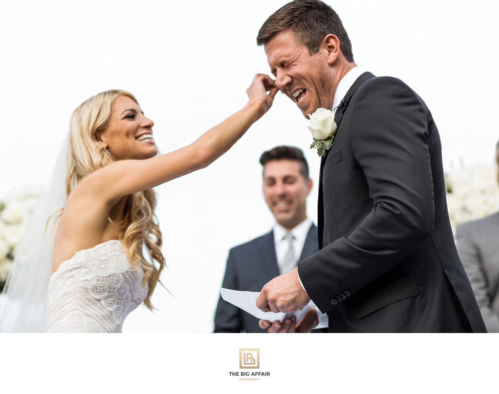 Bride wiping grooms tears