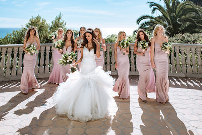 Bridal party walking on the patio of Bel Air Bay Club