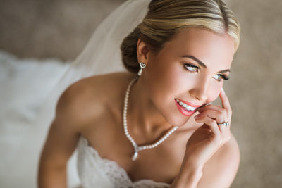 A smilling portrait of the bride