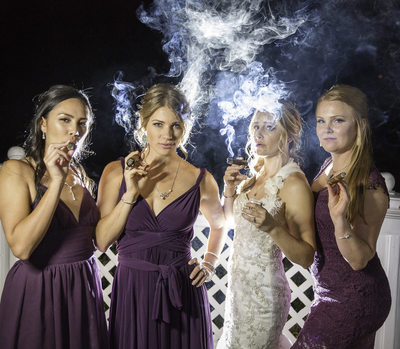 Bridesmaids smoking a cigar