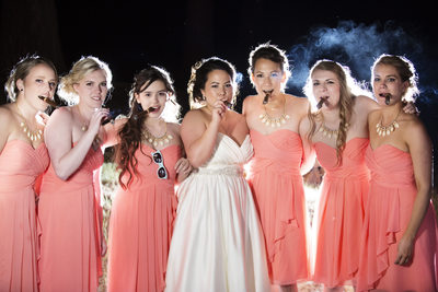 Bridesmaids smoking Cigars