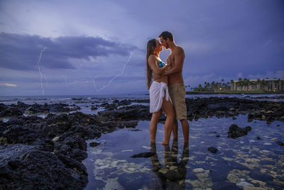 Destination Engagement session in Hawaii lighting volcano