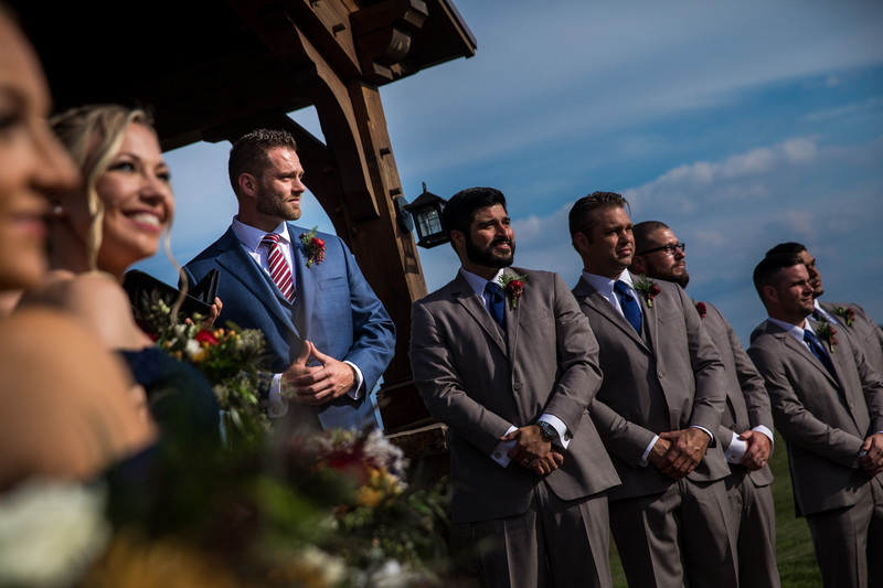 Groom Watches Bride Walk Down Aisle at Wyndridge Farm