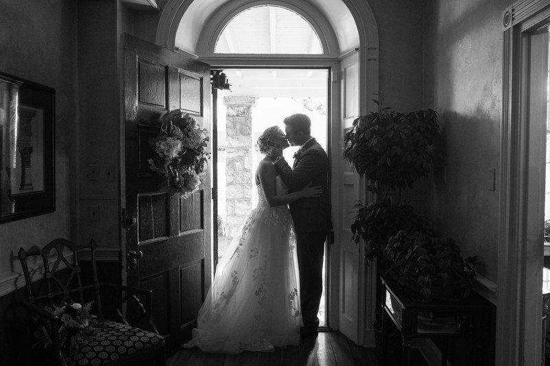 Bride and Groom Kissing at Peter Allen House