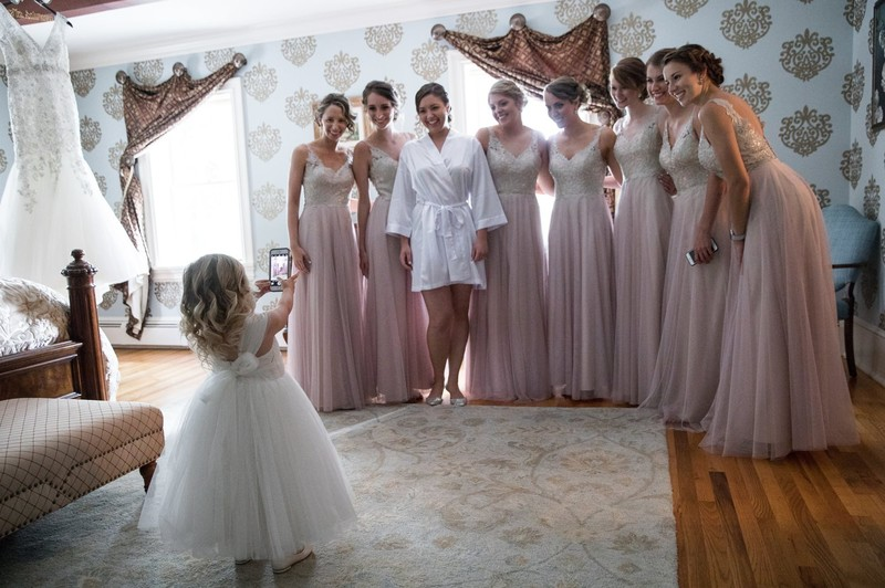 Flower girl and bridesmaids in wedding getting room