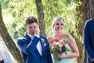 Groom crying at The Farm at Eagles Ridge