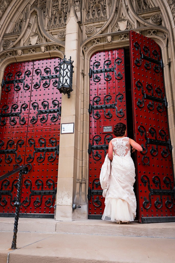 Bride entering Heinz Chapel Red Doors