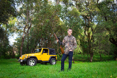 Senior guy with his gun and jeep.