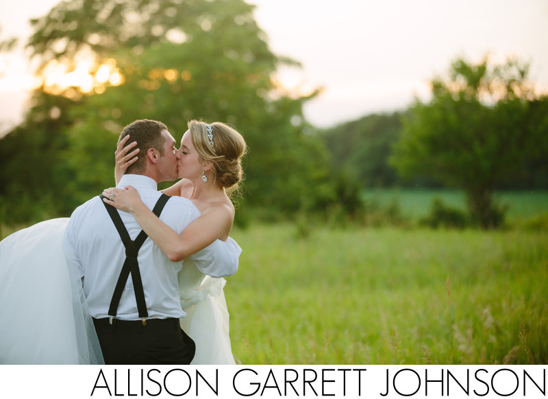 Groom Holds Bride at Sunset on Farm