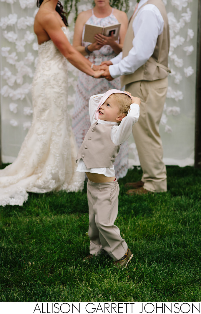 Ring Bearer Distracts Guests at Harmon Park Ceremony