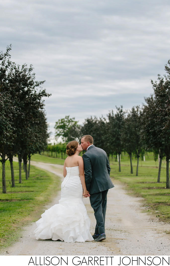 Couple Walks Path at Bluestem Tree Farm