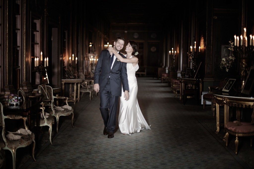 Bride and Groom embrace on their wedding day at Syon Park in Richmond UK