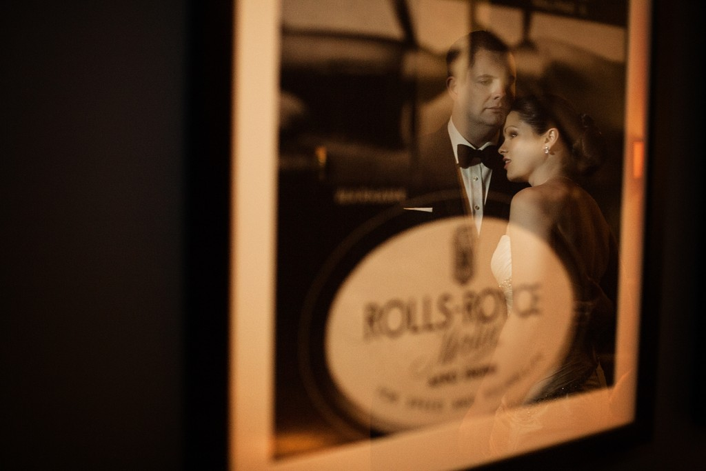 bride and groom reflected in a vintage picture frame at the Aviator Hotel in Farnborough