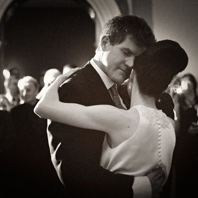 Emotional image of a bride and groom during their first dance at Hampton Court House