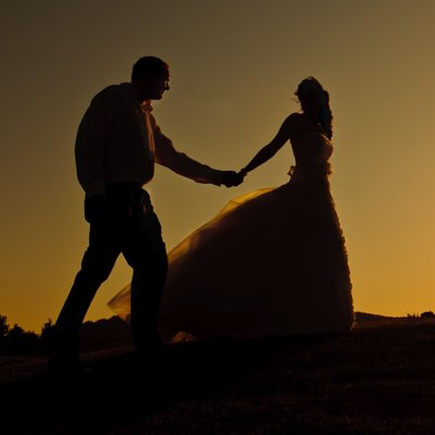 Bride and Groom with a sunset on their wedding day