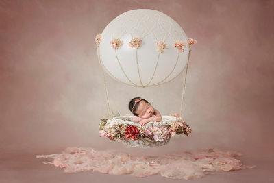 Newborn girl in hot air balloon