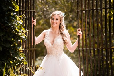 Bride by Gate at Holly Hedge