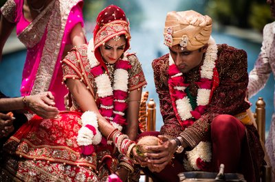 Couple with Coconut at Hindu Wedding