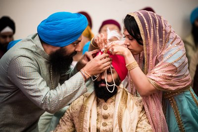 Helping Groom with Turban at Sikh Wedding