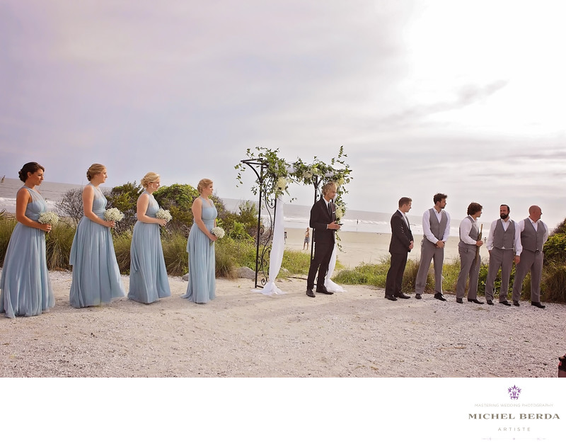 Groom and bridal party wedding ceremony at Sea Side Point Wild Dunes Resort
