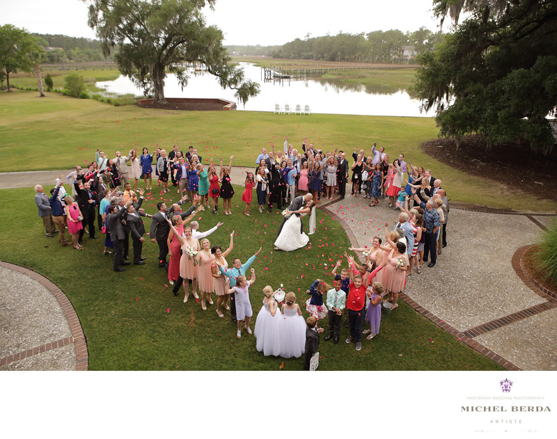 Heart with bride and groom & bridal party family and friends Dunes West Golf & River Club