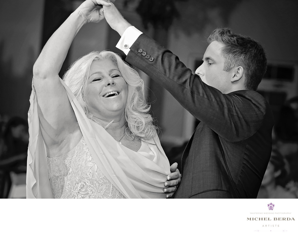 Mom and son twirl dance at Palmetto Hall Wild Dunes Resort