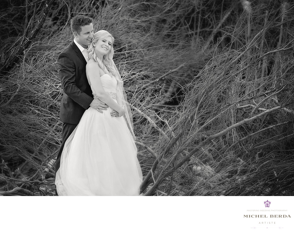 Bride and Groom B&W by trees on the beach wedding ceremony at Sea Side Point Wild Dunes Resort