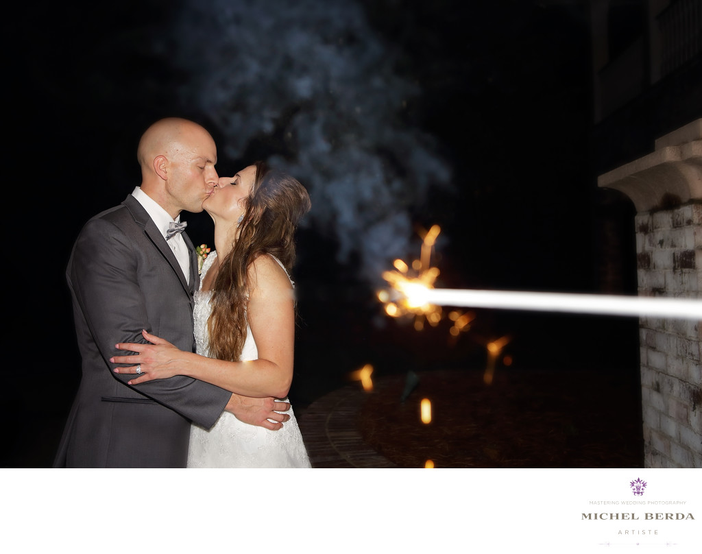 Leaving sparkler kiss bride and groom Dunes West Golf & River Club