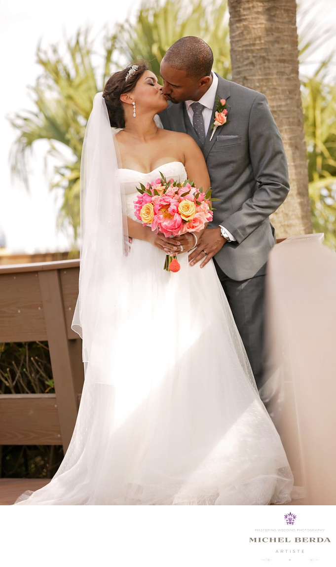 Bride and groom kiss deck THE WESTIN HILTON HEAD ISLAND RESORT & SPA