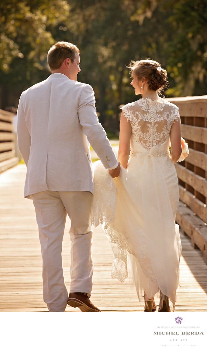 Bride and groom walking Weddings Palmetto Dunes Oceanfront Resort