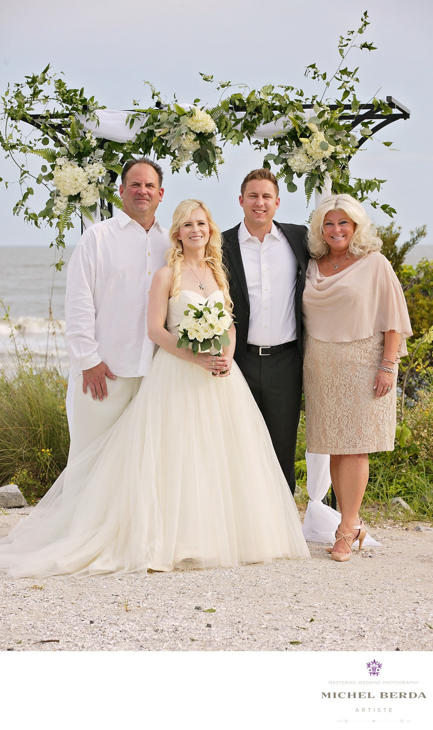 Family portrait wedding ceremony at Sea Side Point Wild Dunes Resort