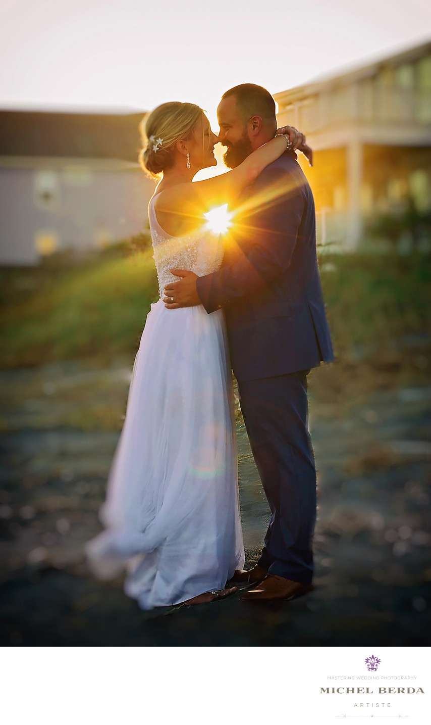 A wedding couple with the perfect sunset photo.