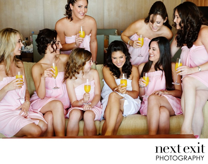 Bridesmaids in towels sipping mimosas