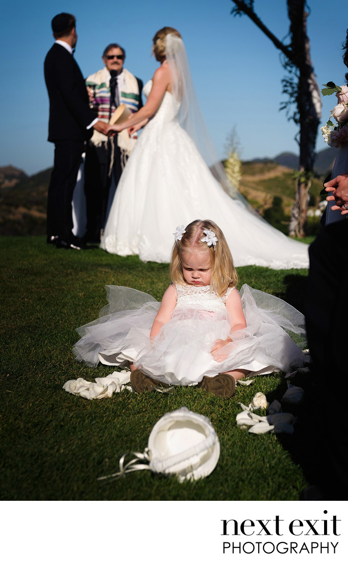 Flower girl in the aisle at Saddlerock Ranch wedding