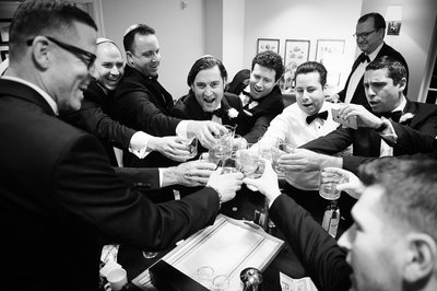 Groomsmen toast in the Board Room at the Hotel Casa Del Mar
