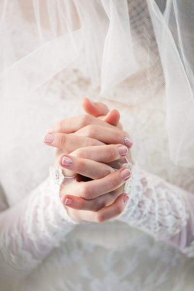 Bride with clasped hands