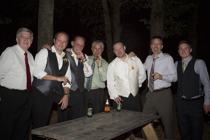 Cigar break for the men at wedding reception.