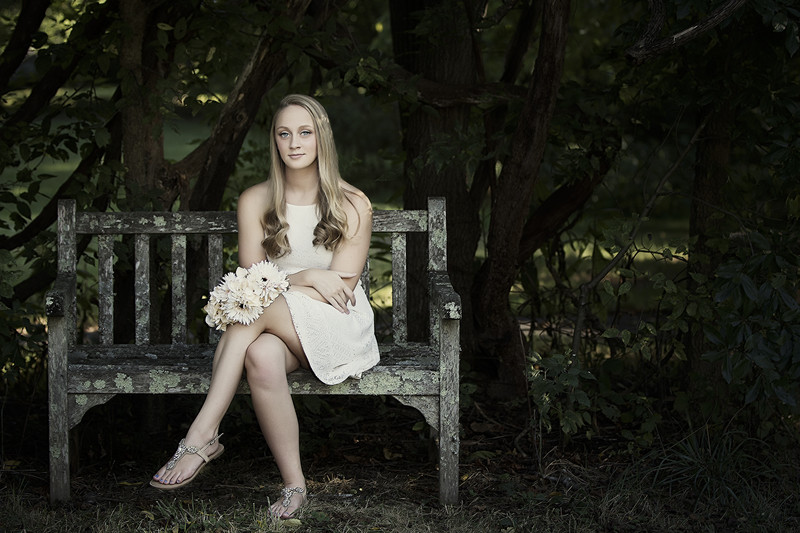 Senior Portrait of a girl on a bench in Ivy Creek Nature Center