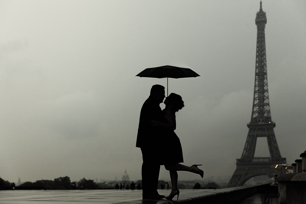 Couple with umbrella Trocadero Eiffel Tower Paris