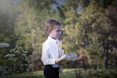Ring bearer with pillow at Montfair Resort Farms