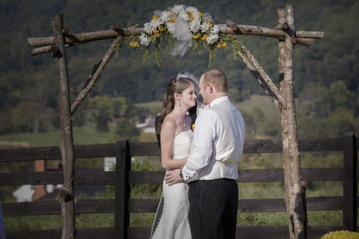 Newly Married Couple under the floral arch