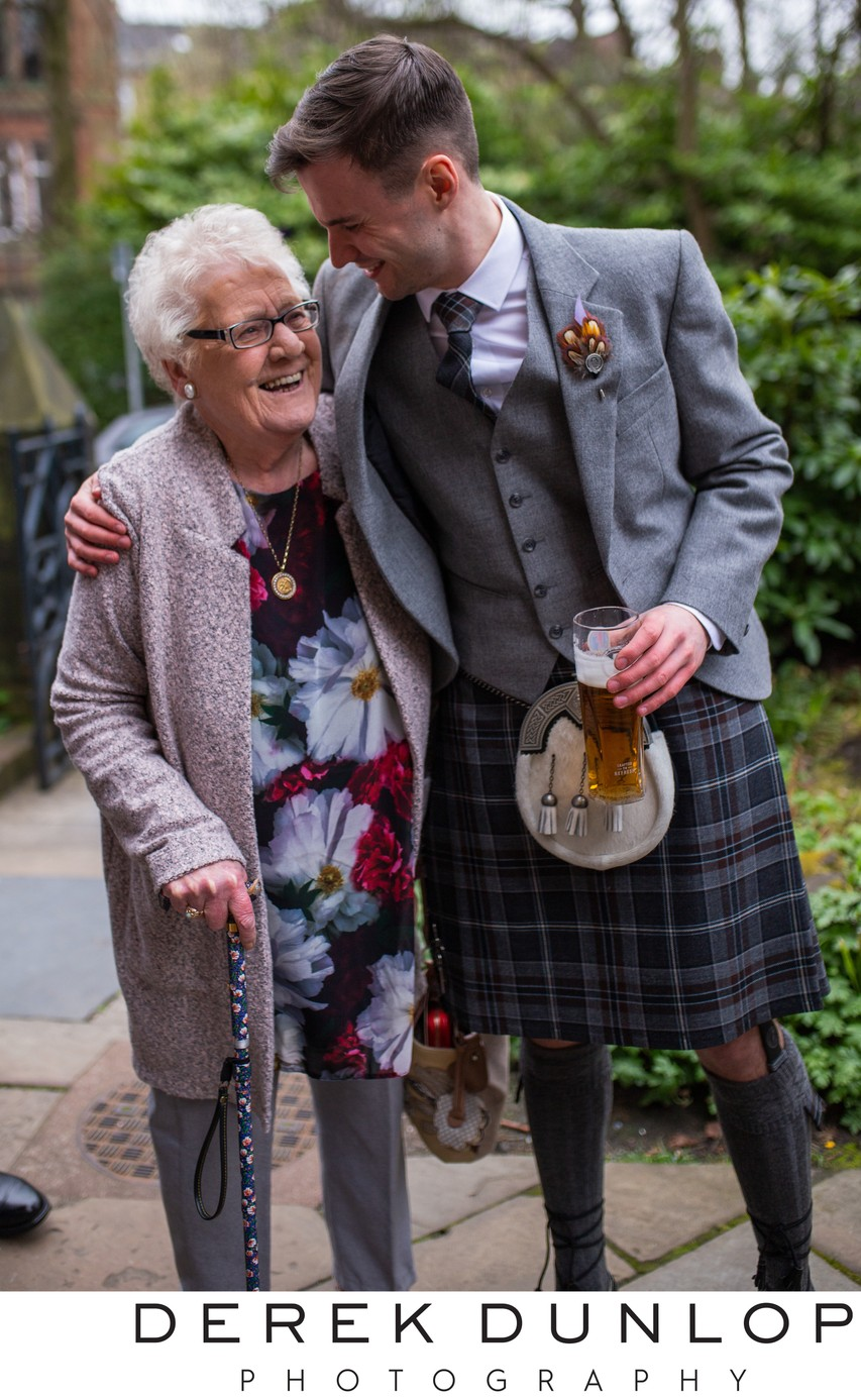 reportage wedding photo in glasgow with groom & gran