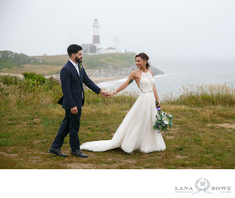 Bride and groom walking at montauk lighthouse