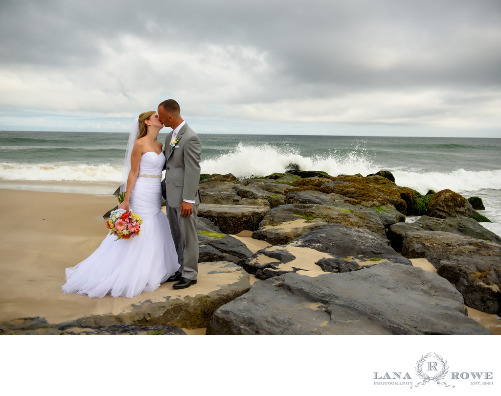 Oceanbleu, Westhampton  bride and groom kiss on the rocks