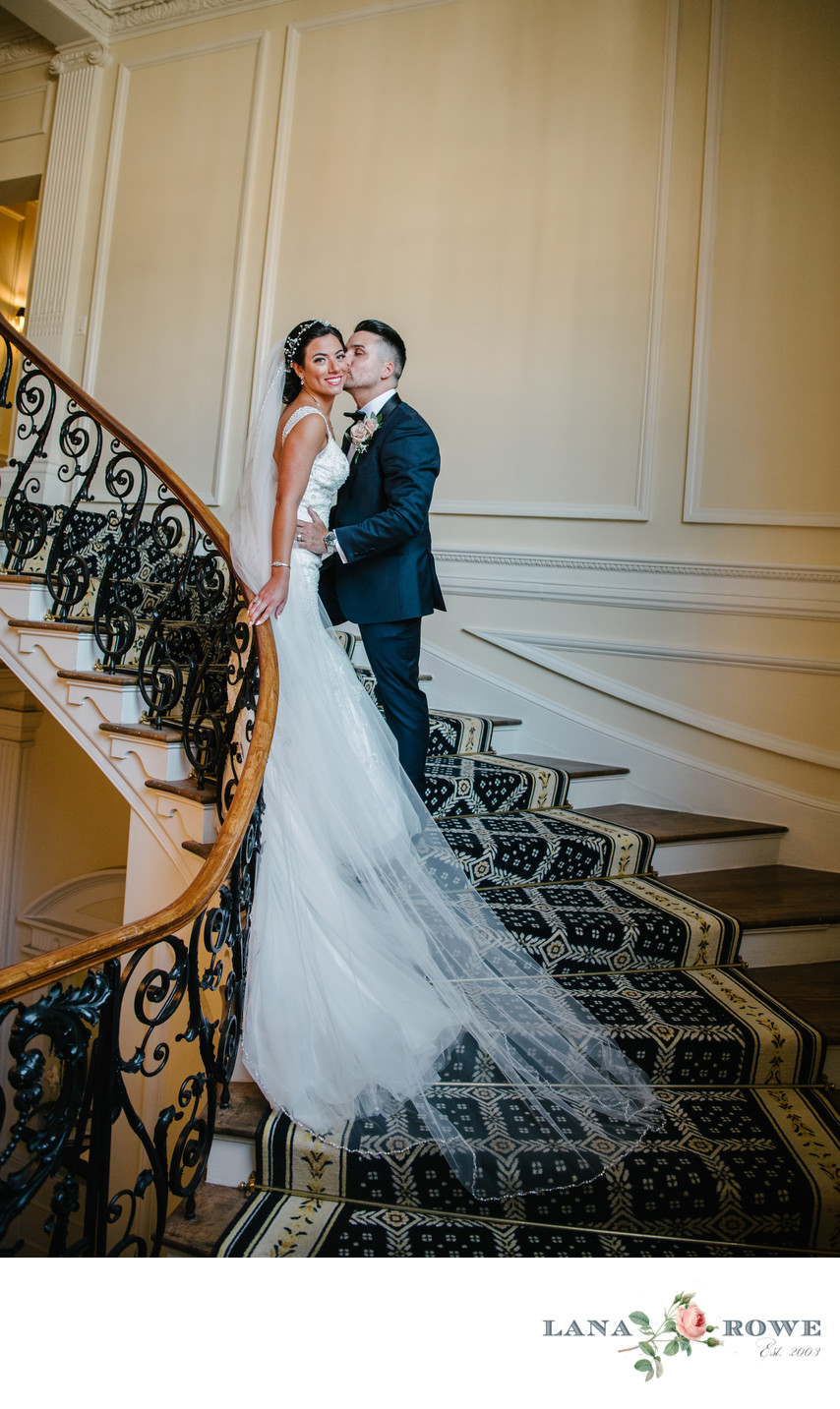 Bride and Groom on the staircase in the Muttontown Club