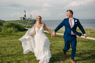 Bride and Groom running at Camp Hero,  360 east Montauk Downs